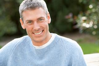 Man with Crowns Smiling | Aurora CO Dentist