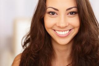 Woman smiling with Tooth Colored Fillings | Cosmetic Dentist Aurora CO