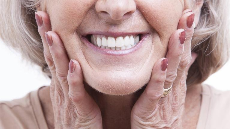 Dental Bridge Restorations in Aurora | Smiling Woman