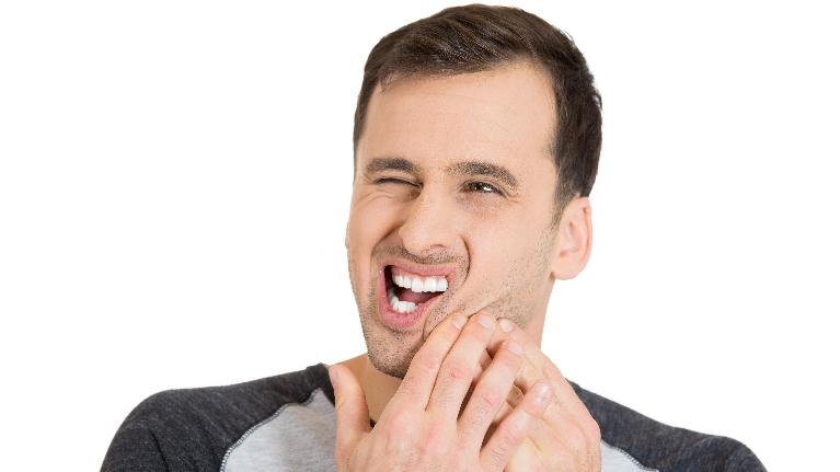Man Holding Jaw in Pain | Emergency Dental Office in Denver